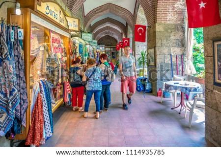 Unidentified people visit and do shopping at  historical Koza Han(Silk Bazaar) in Bursa,Turkey.20 May 2018 #1114935785