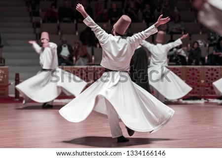 Unidentified whirling Dervishes or Semazen in Konya, Turkey Stock photo ©