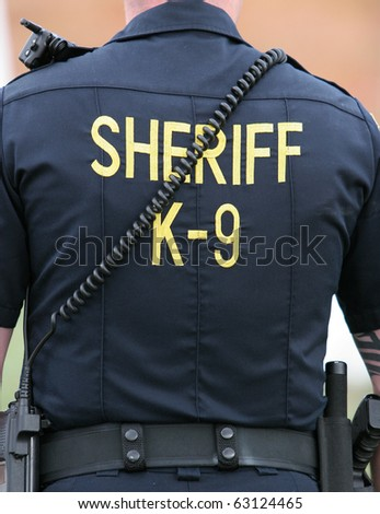 Uniform shirt of a K-9 unit officer from a US sheriff's department - stock photo