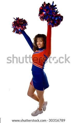 Uniformed cheerleader strikes a pose with pom poms  isolated on white.
