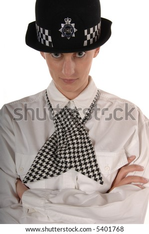 Uniformed UK female police officer giving stern look isolated on white