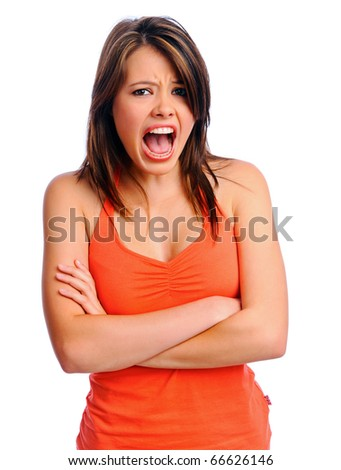 Unimpressed brunette girl screams at camera with arms crossed - stock photo