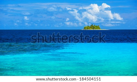 Uninhabited island in the sea, transparent blue water, virgin wild nature, scenes destination, sunny day, exotic travel and tourism concept