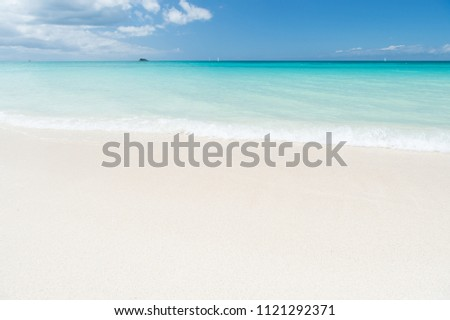 Uninhabited island. Sand pearlescent white claim as fine as powder. Clouds blue sky over calm sea beach tropical island. Tropical paradise beach with sand. Travel experts reveal Antigua best beaches.