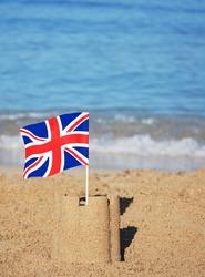Union Jack flag in sand castle on a beach