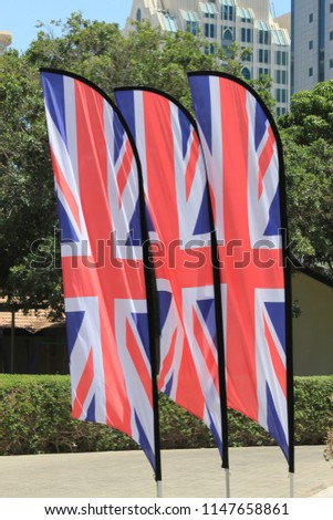Union Jack flags blowing in the wind. The Union Jack or Union Flag, is the national flag of the United Kingdom. #1147658861