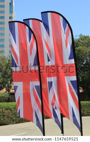 Union Jack flags blowing in the wind. The Union Jack or Union Flag, is the national flag of the United Kingdom. #1147659521