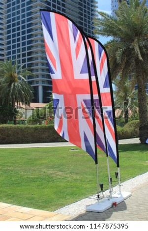 Union Jack flags blowing in the wind. The Union Jack or Union Flag, is the national flag of the United Kingdom. #1147875395
