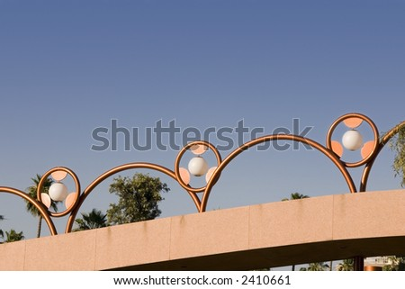 Unique Abstract Brass Lighting along the Bridge - stock photo