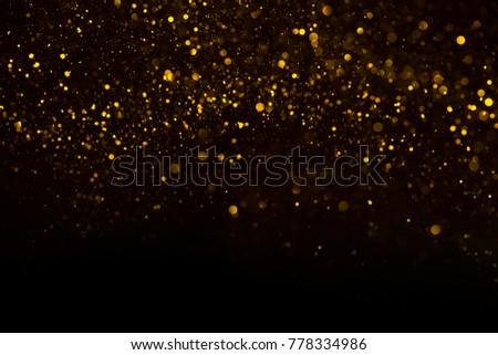 Unique abstract gold dust rain bokeh background