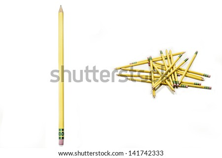 Unique arrangement of simple pencils on a white background.  Great for a back to school or office theme. - stock photo