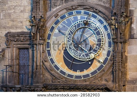 Unique astronomical clock on gothic Old Town Hall in Prague supplemented with a round calendarium including zodiac signs painted by Josef Manes (1865). View at night lighting.