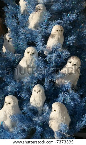 unique blue christmas tree with white owl ornaments