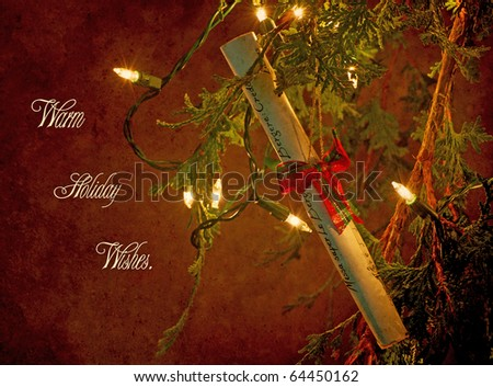 Unique Christmas card design featuring a pretty music sheet ornament hanging from a Christmas tree illuminated by sparkling lights.