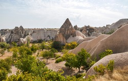Unique fancy geological mountain formations with dovecotes of the Pigeon valley in Goreme, Cappadocia, Turkey