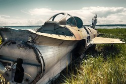 Unique foto. war plane crashed on shore of sea several years ago and lies on grassy dunes. Different camera angles at different times