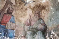 Unique fresco Holy Trinity: Father, Son, Holy Spirit (dove), temple of Archangel Michael, 19th century. Concept — cultural heritage, rebirth, restoration, faith, Christianity. Travel to Russia.