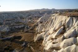 Unique geological formations in Cappadocia, Turkey. Valley with white sandstone rock formations.