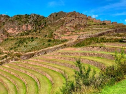Unique green agricultural terraces of ancient incas. Old incan fortress in the Sacred Valley near Pisac town, Peru. Beautiful peruvian summer landscape. The Pisac ruins. Citadel of Inkas on mountain.