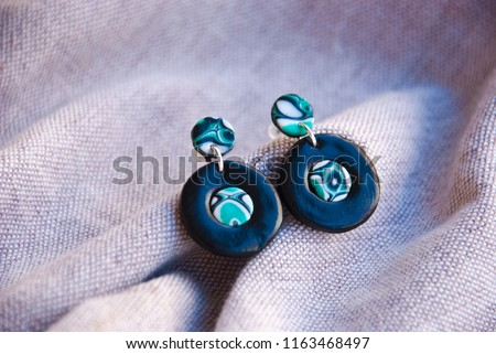 Unique handmade abstract earrings of polymer clay. Black small earrings stud.Fashion background. #1163468497