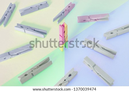 Unique, individuality, leadership and think different concept. One wooden clip difference with other clips, with contrast vintage pastel colored