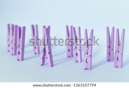 Unique, individuality, outstanding,leadership and think different concept. Purple wooden clip stand out of other clips