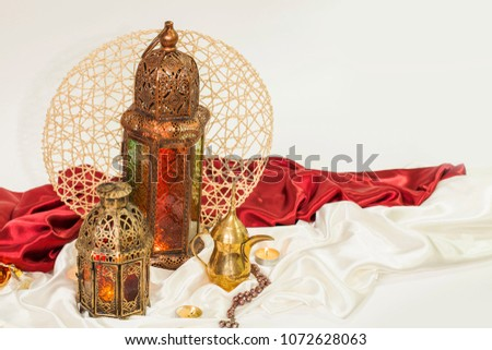 "unique lantern with ""dallah"" Arabian coffee on satin texture background #1072628063"