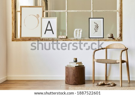 Unique living room in modern style interior with design wooden chair, stool, decoration, mock up poster frames on the old window, book and elegant accessories in home decor. Template.
