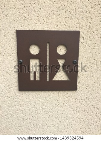 Unique metal sign with cutouts of a man and woman to alert you to where the restrooms, washrooms and or water closets are. #1439324594