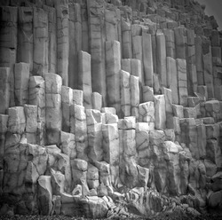 Unique natural basalt rock pillars columns  in Iceland. Geological wonder hexagonal volcanic formations in Vik beach.