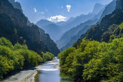 Unique natural landscape from the Vikos–Aoös National Park. The towering mountain peaks of Pindus mountain, the spectacular Vikos Gorge carved by the Aoös river compose the geopark. Epirus. Greece.