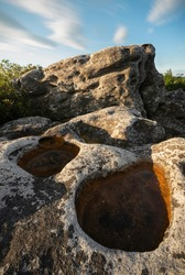 Unique rock formations at Dolly Sods in West Virginia just after sunrise bathing in golden light.
