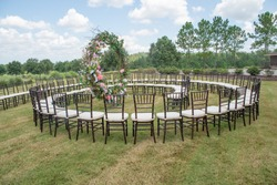 Unique round spiral chair pattern wedding ceremony setting at ro