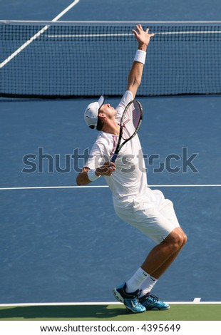 Unique shot of John Isner, a rising American pro tennis star, completing a serve at Leggmason 2007. It was his first big pro tournament where he got defeated in the final by Andy Roddick.