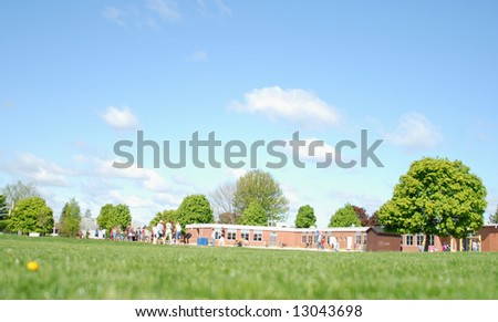 unique view of outside of public school at recess