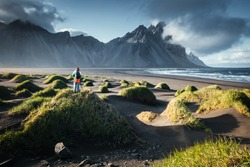 Unique view on green hills with sand dunes. Location Stokksnes cape, Vestrahorn (Batman Mount), Iceland, Europe. Scenic image of tourist attraction. Travel destination. Discover the beauty of earth.