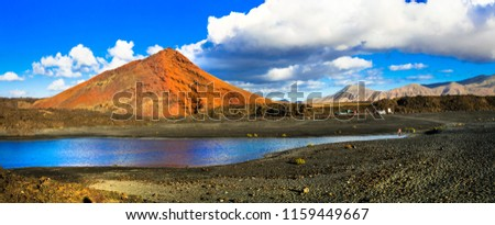 Unique volcanic nature of Lanzarote island with black sands and red rocks. Canary islands of Spain