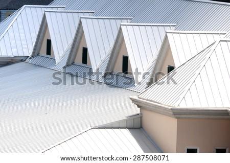 Unique white triangular shaped aluminum metal roof designed for maximum rain repulsion and heat reflection