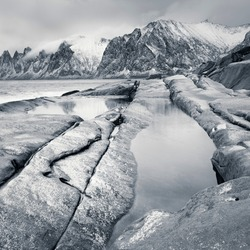 Unique winter sea landscape, black and white. The beauty of the Northern nature. Norway, island of Senja.