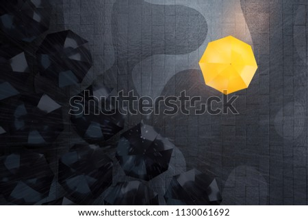 Unique yellow umbrella and group of dark ones. Standing out from crowd, individuality and difference concept. 3D illustration
