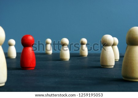 Uniqueness, originality, difference and distinction. Wooden figures and red one. #1259195053