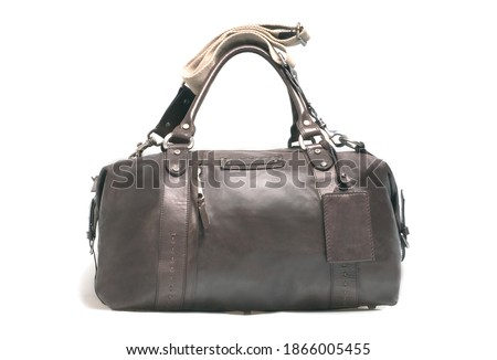 Unisex story (ever green)  handbag in brown leather. Casual duffle bag. Isolated on white. Studio shot. Selective focus. Photo stock ©