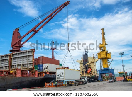 unit of container during loading from port yard to accommodate onto the bay of the ship, stevedore in charge of carry out fitting container shoe prior load on to vessel #1187682550