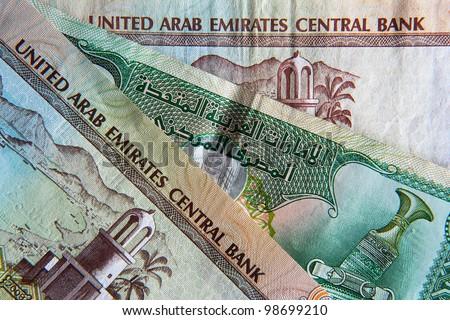 United Arab Emirates banknote background, English The UAE is made up of seven states: Abu Dhabi, Dubai, Sharjah, Ajman, Umm al-Quwain, Ras al-Khaimah and Fujairah.