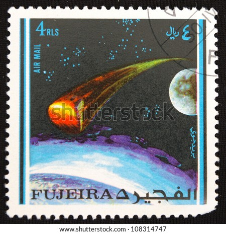 UNITED ARAB EMIRATES - CIRCA 1974: A stamp printed in United Arab Emirates shows air mail, circa 1974 - stock photo