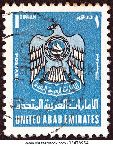 UNITED ARAB EMIRATES - CIRCA 1977: A stamp printed in United Arab Emirates shows an eagle (U.A.E. emblem), circa 1977.