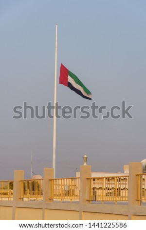 United Arab Emirates Flag flies at half mast due to mourning after the death of a ruler in the United Arab Emirates.