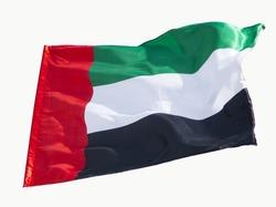 United Arab Emirates flag flying with blue sky background
