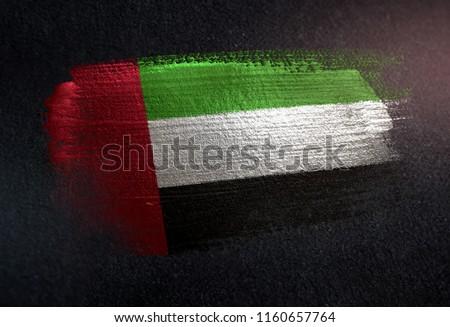 United Arab Emirates Flag Made of Metallic Brush Paint on Grunge Dark Wall