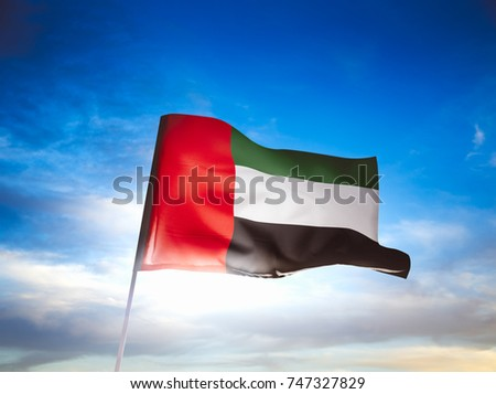 United Arab Emirates flag waving with pride on a sunny day